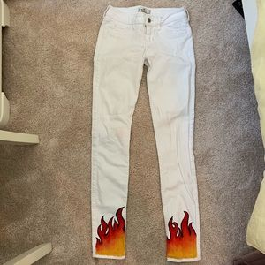 white flame painted skinny jeans
